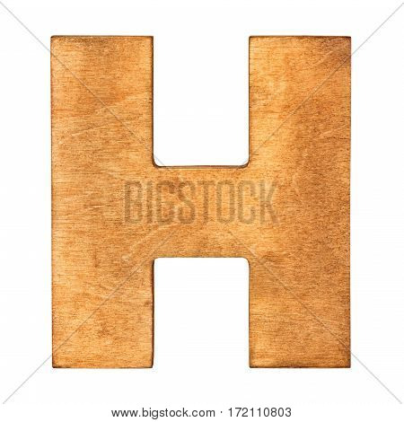 Old wooden letter H on wooden background. One of full alphabet wooden set