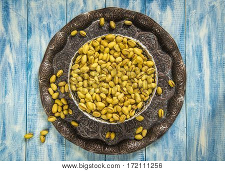 Iranian pistachios on traditional copper plate