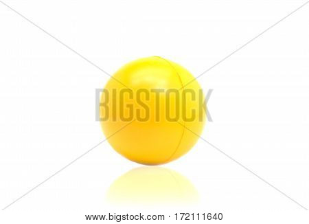 Yellow plastic ball isolated on white background.