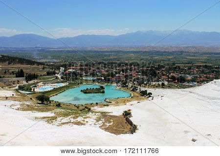The lovely mountain lake pleases the eyes of tourists on travertine