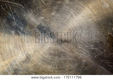 old scratched the bottom of a metal baking pan or round as an industrial background.
