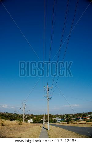 Electric column at the side of the road with dried grass