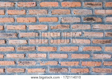 Old vintage brick wall and mortar background texture.