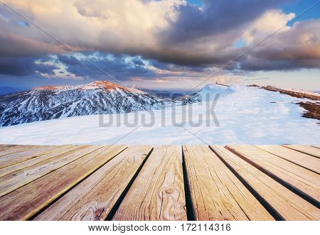 Mysterious winter landscape majestic mountains in winter and shabby table . Magical snow covered tree. In anticipation of the holiday. Dramatic wintry scene. Carpathian. Ukraine. Happy New Year.