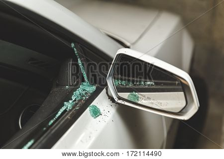 Broken Window On White Car