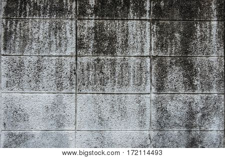 Old cement block wall with paint abrasive background texture.