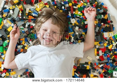 Child playing with colorful toys. Boy with educational toy blocks. Children play at day care or preschool.