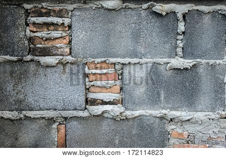 Old cement block with brick wall texture.