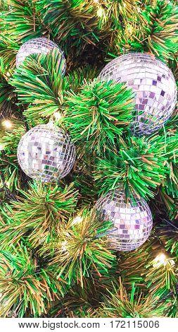 Decorate mirror silver ball on green Xmas tree