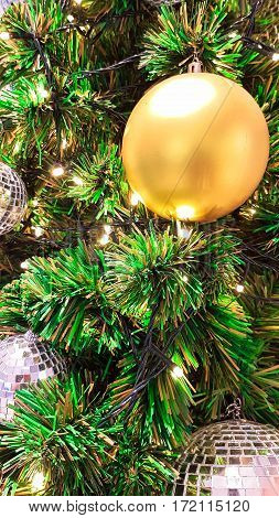 Decorate golden ball and mirror ball on green Xmas tree