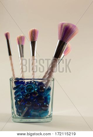 Makeup brushes with unicorn handles and multicolored brush