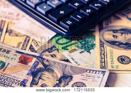 Dollar And Euro Bils, Check And Black Calculator.