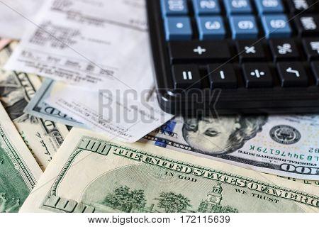 Dollar Bils, Check And Black Calculator.