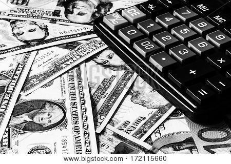 Dollar Bils And Black Calculator.