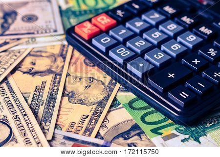 Dollar And Euro Bils And Black Calculator.