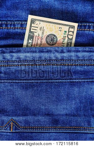 Dollar Bill In The Pocket Of Jeans.