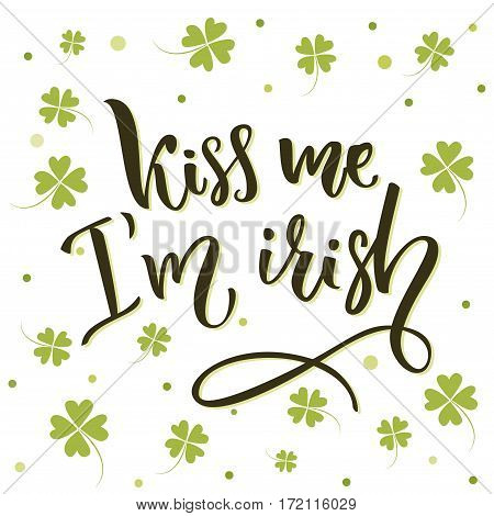 Kiss me, I'm irish. Funny St. Patrick's day quote for t-shirts and cards at four-leaf shamrock background