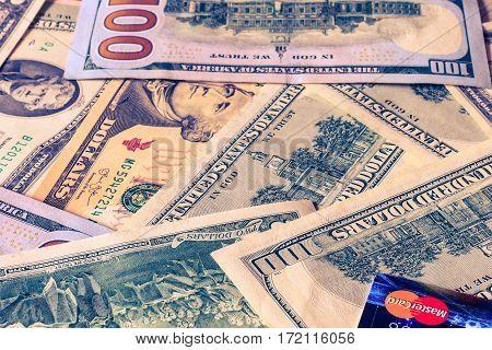 Photo Of  Mastercard Credit Card With Usa Dollars Bills.