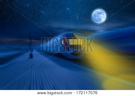 High-speed train passing station with motion blur moon and stars in night sky