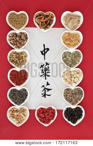 Chinese herbal tea selection in heart shaped bowls with calligraphy on rice paper. Translation reads as chinese herb tea. Used also in herbal medicine,