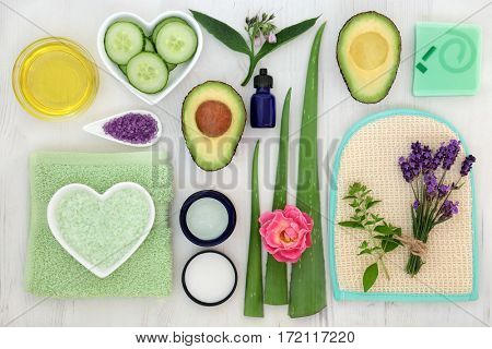 Beauty treatment ingredients for skin and body care on distressed white wood background.