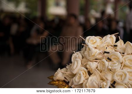 Sandalwood flowers or artificial flowers or wood cremation flower, kind of wood flower to be placed on the site of cremation or used during a funeral