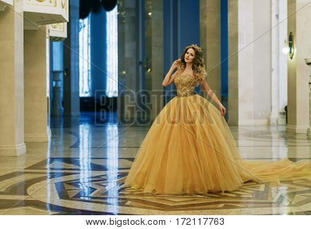 Beautiful Woman In A Long Dress And A Golden Crown In The Great Hall