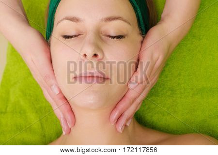 Spa relaxation skincare healthy pleasure concept. Woman lying with closed eyes having relaxing face massage