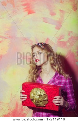 Pretty Girl With Red Gift Box With Golden Bow
