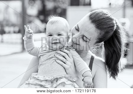 Portrait photo of adorable baby girl with her mother