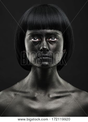 Natural Portrait Of A Dark-skinned Beautiful Girl. Black Beauty Face. No Photoshop.