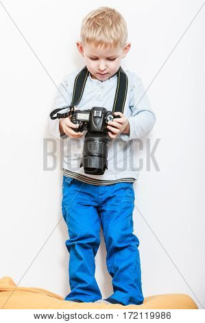 Little Boy Play With Camera.