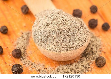 Black pepper on the spoon. Food and kitchen