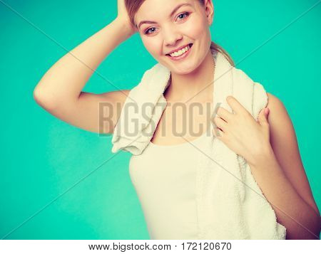 Woman With A Towel Around Her Shoulders Smiling