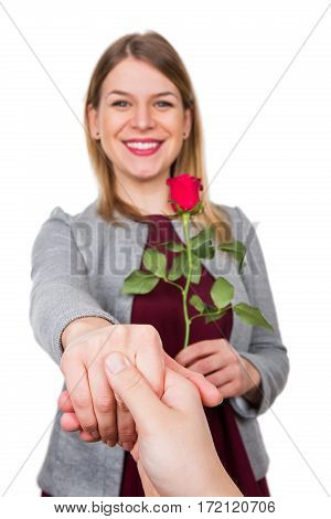 Picture of a happy beautiful woman with a red rose on Valentine's day