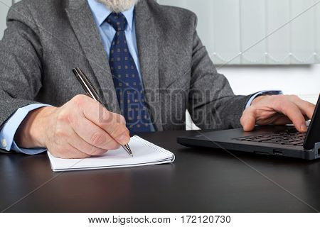 Close up picture of a male employer's hands at the office