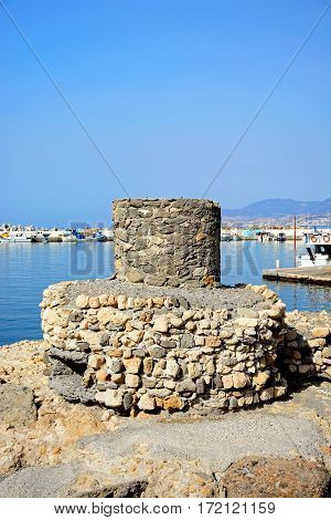 IERAPETRA, CRETE - SEPTEMBER 18, 2016 - Old tower ruin at the entrance to the harbour Ierapetra Crete Greece Europe, September 18, 2016.