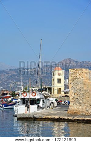 IERAPETRA, CRETE - SEPTEMBER 18, 2016 - Boats in the harbour with Kales Venetian fortress to the right hand side and the church to the rear Ierapetra Crete Greece Europe, September 18, 2016.