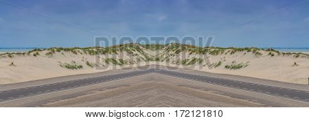 Panorama of a sunny natural landscape with great sand dunes in the Netherlands.