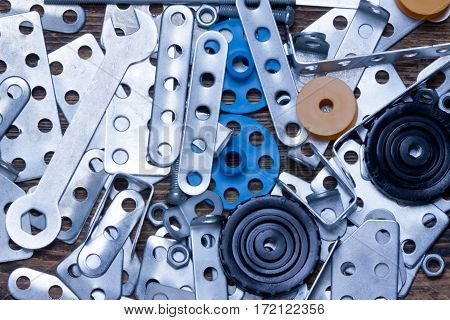 various metal details and wrench closeup.background.top view.
