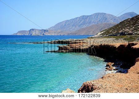 View of the beach and rugged coastline near Ammoudara Crete Greece Europe.