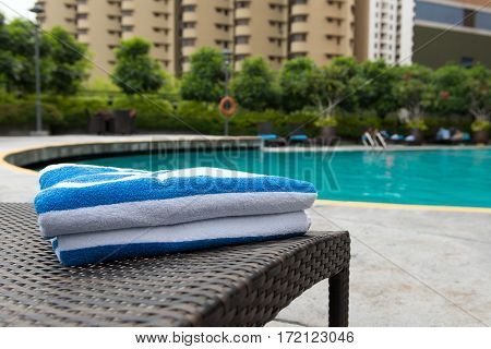 Close up of towels on deck chair at resort pool