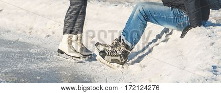 girl and man skating on ice in winter