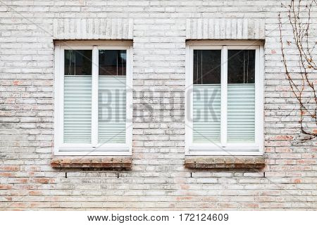 Gray Brick Wall With Two Windows