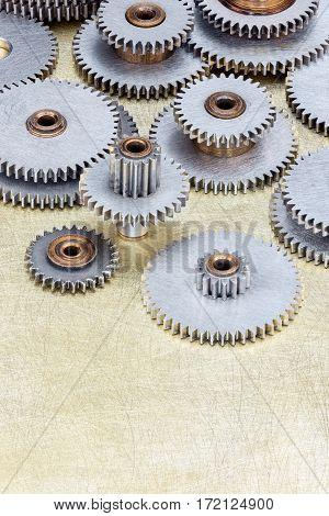 Set Of Different Gear Cogwheel On Brass Metal Background