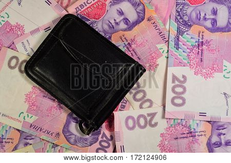 Black Money Clip On A Background Of The Ukrainian Banknotes