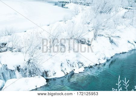 Panoramic view on frozen lake in nature park Plitvice, Croatia