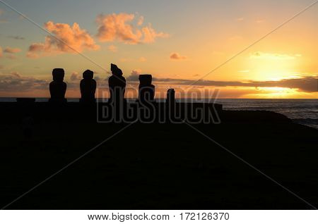 Long shot of the Moai during sunset at Ahu Tahai in Hanga Roa in Rapa Nui Easter Island Chile South America