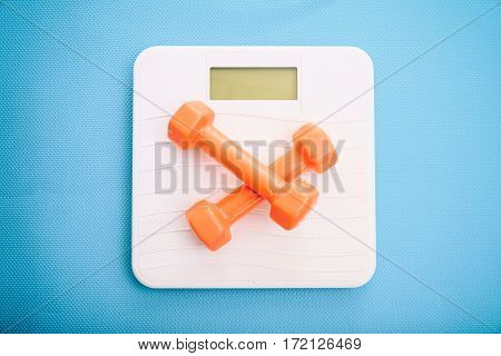 Bathroom Scale And Dumbbells