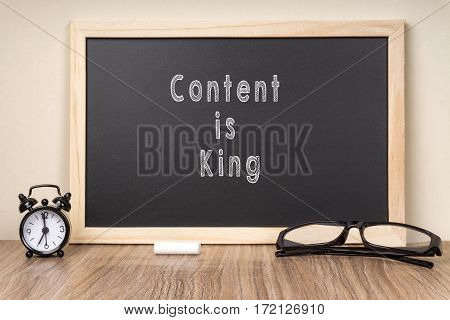 'Content Is King' word on chalkboard with chalk.